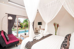 Luxury and Beautiful Bedroom Villa. Beautiful interior and Bedroom villa and Hotel in Bali property with wooden bed and white netting stock images