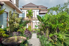 Luxury and Beautiful exterior garden villa. Beautiful exterior villa and Hotel in Bali style property, Indonesia with green open space garden stock photos