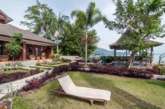 Luxury and Beautiful exterior garden villa. Beautiful exterior villa and Hotel in Samosir Island, North Sumatra, Indonesia with green open space garden and stock image