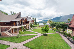 Luxury and Beautiful exterior garden villa Lakefront. Beautiful exterior villa and Hotel in Samosir Island, North Sumatra, Indonesia with green open space garden stock image