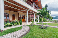 Luxury and Beautiful exterior garden villa Lakefront. Beautiful exterior villa and Hotel in Samosir Island, North Sumatra, Indonesia with green open space garden royalty free stock photos
