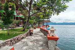 Luxury and Beautiful exterior villa in Samosir Island. Beautiful exterior villa and Hotel in Samosir Island, North Sumatra, Indonesia with open space and royalty free stock photo
