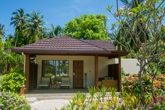 Luxury beautiful small house on the beach located at the tropical island Royalty Free Stock Photos
