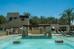 Luxury beautiful swimming pool in desert arabian five star resort Royalty Free Stock Photo