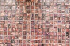 Wall of brown mosaic with different shades royalty free stock image