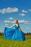 Luxury beautiful woman in long evening fashionable dress outdoor Stock Photos