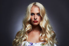 Luxury beautiful young woman with healthy curl blond hair Royalty Free Stock Images