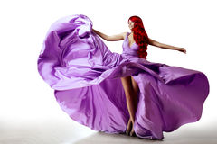 Luxury beautiful young woman in a long evening dress. Girl in fl Royalty Free Stock Photo