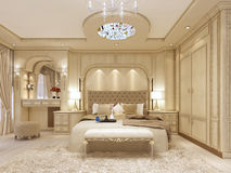 Luxury bed in a large neoclassical bedroom with decorative niche. In the wall. Dressing table and stool. 3D render Stock Photography