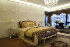 Luxury bedroom. Interior of a luxury bedroom with large windows Royalty Free Stock Photography