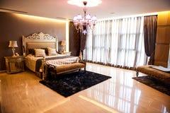 Luxury Bedroom. Modern, warm, inviting bedroom or hotel room.Luxury Bedroom Stock Images