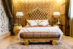 Luxury Bedroom. Modern, warm, inviting bedroom or hotel room.Luxury Bedroom Stock Photography