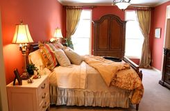 Luxury bedroom. Closeup shot of Luxury bedroom is decorated with furniture Stock Images