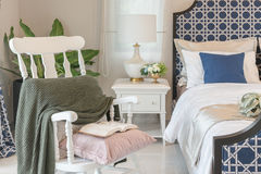 Luxury bedroom in blue color tone with white wooden rock chair Stock Images