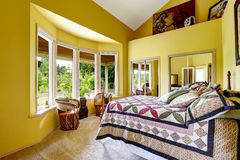 Luxury bedroom in bright yellow color Royalty Free Stock Photo