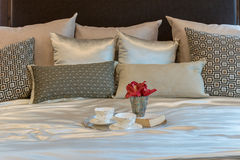 Luxury bedroom with brown pattern pillows and decorative tray Royalty Free Stock Photo