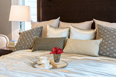 Luxury bedroom with brown pattern pillows and decorative tray Stock Images