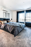 Luxury bedroom with a carpet floor view at day time Royalty Free Stock Images