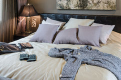 Luxury bedroom with clothes and bag Stock Photo