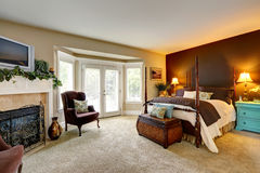 Luxury bedroom with  fireplace and walkout deck Royalty Free Stock Photography