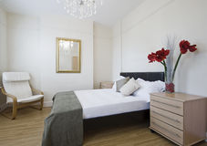 Luxury bedroom with flowers Royalty Free Stock Photo