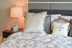 Luxury bedroom interior with flower pattern pillows and table lamp Royalty Free Stock Images