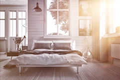 Luxury bedroom lit by warm glowing sun flare. Luxury spacious airy bedroom lit by warm glowing sun flare streaming in through one of the multiple windows with Royalty Free Stock Photo