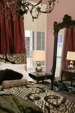 Luxury bedroom with mirror. Luxury classic bedroom with wall mirror royalty free stock photo