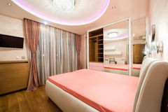 Luxury bedroom with modern ceiling lights Stock Images
