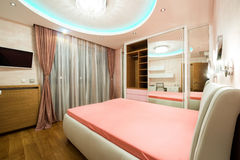 Luxury bedroom with modern ceiling lights Royalty Free Stock Image