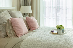 Luxury bedroom with pink pillows and white tray of flower on bed Royalty Free Stock Photography