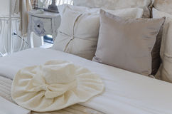 Luxury bedroom style with fashion hat on bed Stock Image