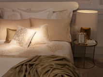Luxury bedroom. In sweet white, golden and beige colours Stock Photography
