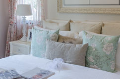 Luxury bedroom with vintage color pillows on bed Stock Photo