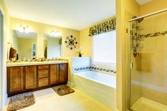 Luxury beige bathroom with vanity cabinet and bath tub Royalty Free Stock Photo
