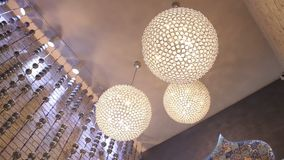 Luxury big round chandeliers. stock video footage
