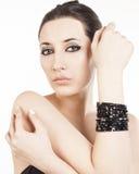 Luxury black bracelet. Young brunette lady with luxury black bracelet  on white background Royalty Free Stock Image