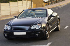 Luxury black cabriolet vehicle stock images