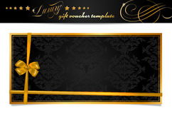 Luxury black and gold gift voucher with bow Stock Images