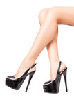 Luxury black high heel shoes in perfect legs isolated on white Stock Photos