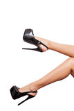 Luxury black high heel shoes in perfect legs over white Royalty Free Stock Photo