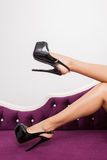 Luxury black high heel shoes in perfect legs Stock Image