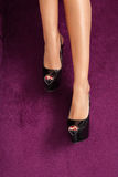 Luxury black high heel shoes in perfect legs Stock Photography