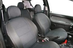 Luxury black leather car interior stock photography