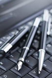 Luxury black pen on computer keyboard Stock Photography