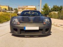 Luxury black sport car. Close up Stock Photos