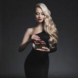 Luxury blonde with a Christmas gift royalty free stock photos