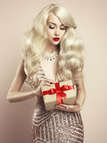 Luxury blonde with a Christmas gift Stock Images