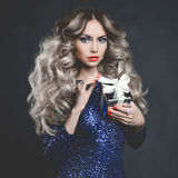 Luxury blonde with a gift. Fashion photo of luxury blonde with a gift Royalty Free Stock Photos