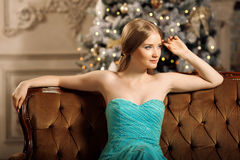 Luxury blonde in interior New Year. Young beautiful trendy girl Royalty Free Stock Photo